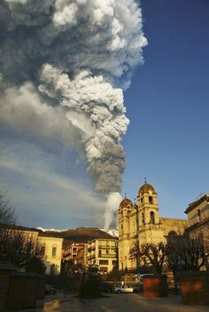 VOLCANO ERUPTION: Smoke and ash billows from Mount Etna framed by the Sicilian town of Zafferana, near Catania, southern Italy. #etna #sicily #sicilia