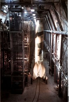 Mittelwerk underground factory, Kohnstein near Nordhausen, Germany: A completed Vergeltungswaffe 2, ('Retribution Weapon 2') or V-2 rocket, is being moved. Built in 1944, as a brilliant but desperate response to the constant Allied bombing of German cities, it would surpass Mach 4 and was the first man-made object to reach outer space.