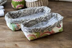 This tutorial shows you how to make a fabric caddy with two coordinating fabrics. The two showing are used to hold utensils for party guests.