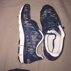 Nike 5.0 shoes I have a pair of Nike 5.0 free shoes, they are excellent condition hardly worn. They are a size 8.5 but they make them small and I'm usually a size 7.5 and they fit perfect. I don't have the box but they'll be shipped well. Thanks for looking! Nike Shoes Athletic Shoes