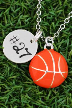 Rep your number with this beautiful hand stamped jersey number and basketball charm necklace! It is sure to make a statement on and off the court. Give this as a girls basketball gift to any player or fan! #womensbasketball #custom