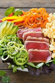 This recipe for ahi tuna salad is seared ahi on a bed of mixed greens ...