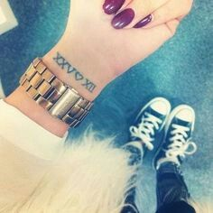 Love the roman numeral tattoo....also the shoes !!!