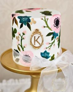 This monogrammed hand-painted wedding cake is almost too pretty to eat.