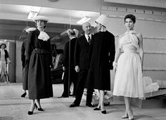 Christian Dior and models in the studio.
