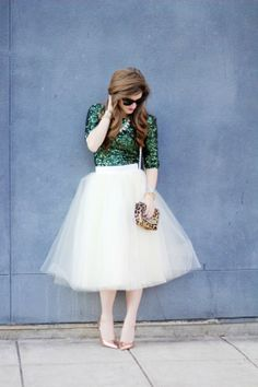 Outfit details: French Connection sparkle dress (worn as a top), Anthropologie earrings, Prada sunglasses, BaubleBar necklace, Kate Spade pumps, Prada totePhoto credit: Brighton the Day via StyleList