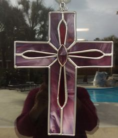 This stained glass cross is named Prince of Peace and the middle sections light up as the sun shines through them. A great Easter or Mother's day gift. Measures 10 inches by 7 inches wide. Customers m