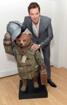 Benedict Cumberbatch with the Paddington Bear that he designed.