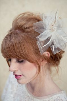 This ticks off all the boxes for my updo. Bangs, loose, 60's style, will work with my fascinator.