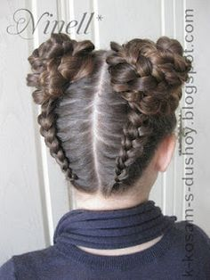 Super intricate double upside down french braids that turn into flowery buns! Pretty hair style