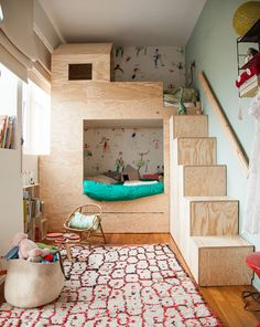 This mod plywood bunk is sleek and fun, the perfect nest for two youngsters on a tight bedroom footprint.