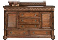 Shop for a Cindy Crawford Home  Key West Dark Pine Door Dresser at Rooms To Go. Find Dressers that will look great in your home and complement the rest of your furniture. #iSofa #roomstogo