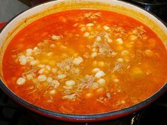 Posoli - pork and hominy soup, nice and spicy on a cool autumn evening. Serve with shredded cabbage and slices of radish.