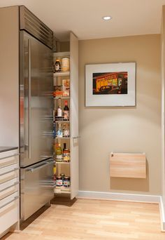 Pull out pantry gets the most out of a narrow space in a small kitchen