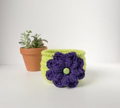 Bright green crochet bowl with purple flower by TheKnottyNeedle