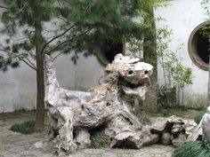 LION SCULPTURE in the centre of the Lion Forest Garden (hence the gardens name) . The most famous attraction in the grotto is the Lion Peak, surrounded by four other stones - Han Hui, Xuan Yu, Tu Yue, and Ang Xiao - which collectively form the Famous Five Peaks.
