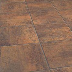 Looks like ceramic tile, but it\'s linoleum flooring. Easier to clean ...