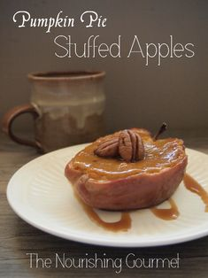These Pumpkin Pie Stuffed Apples  make a beautiful rustic dessert that combines two holiday favorites - apples and pumpkin! And you don't even need to make a crust. Grain free, gluten free, dairy free option - The Nourishing Gourmet