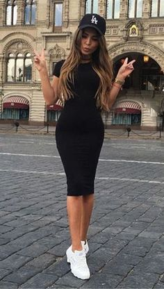 This little black bodycon dress is a perfect day outfit dress with sneakers, a cropped jacket and a smile!