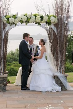 Chuppah with green and white hydrangeas and birch branches