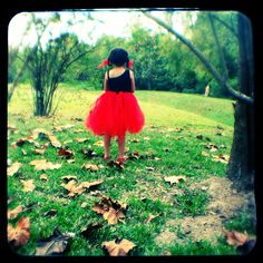 red skirt green grass