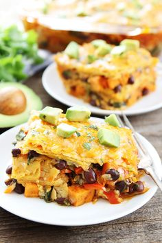 Stacked Sweet Potato and Black Bean Enchiladas Recipe on twopeasandtheirpod.com This layered enchilada casserole makes a great weeknight dinner!