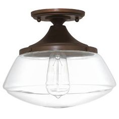 Round out your luminary ensemble in sophisticated style with this one-light semi flush mount, crafted from glass and metal. This flush mount's curved silhouette adds visual appeal to your decor, while its metallic finish adds shimmering style to any monochromatic or vibrant palettes. Play up this piece's versatility by adding it a modern farmhouse living room alongside a pair of linen-upholstered barrel chairs and streamlined sofa for a cohesive and casual seating space, then accent t...
