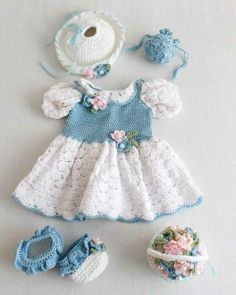 "Design by: Carol Ballard Skill Level: Intermediate Size: To fit 18"" Doll Materials: Worsted Weight Cotton Yarn: White (MC) - 2.5 oz, 122 yd (71 g, 110 m) Size 10 Crochet Thread: Blue (B) - 350 yd; Whi"