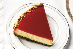 Raspberry Shine Cheesecake. This delicious cake has a shiny mirror-like raspberry glaze that will wow guests at your holiday party. Chill on a baking sheet just in case any of the raspberry glaze leaks through the springform pan.