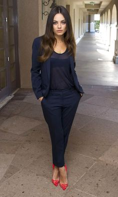 navy suit and coral heels