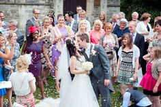 Couple kiss under confetti at Poole Hotel Wedding. Photography by one thousand words wedding photographers