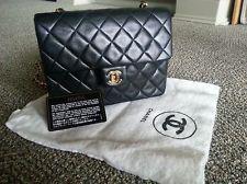 Authentic Chanel vintage black lambskin mini flap