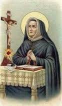 Podemos ver a Santa Magdalena Sofía Barat leyendo la biblia en una mesa.