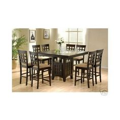 Counter Height Dining Table and Chairs with Lazy Susan by Coaster Home Furnishings, http://www.amazon.com/dp/B0010IEULG/ref=cm_sw_r_pi_dp_ZQuXrb1FTE5NS