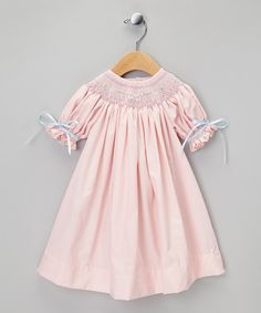 This timeless piece is certainly a dress to impress. Not only do the smocked neckline, gathered sleeves and delicate embroidery showcase meticulous detailing, but the loose silhouette and cozy cotton construction are comfortable too.