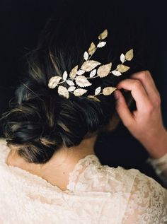 This earthily elegant hair branch features hand-soldered gold leaves and Swarovski rhinestones.   Photo by Erich McVey