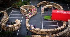 Shipping pallets creating playround and outdoor rooms in a carpark #popup #placemaking ^AH