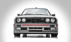 Wrapped Up: Full Matte Silver Vinyl Wrap BMW E30 M3 with Red Accents at NWAS