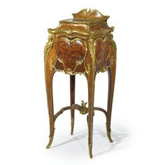 JOSEPH-ÉMMANUEL ZWIENER FL. CIRCA 1875-1900 A GILT-BRONZE MOUNTED KINGWOOD AND END-CUT FLORAL MARQUETRY BED SIDE CABINET PARIS, CIRCA 1889  in the roccoco vein, the top with a green marble inset, the cupboard opening to a white marble inlaid interior, signed E. ZWIENER to the top of the door height 39 1/2 in.; width 16 1/2 in.; depth 16 1/4 in.