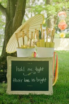 "Cute sign for umbrellas at this sunny Philadelphia wedding: ""Hold me tight. Their love is bright."" (Photo by Lori Gail Photography)"