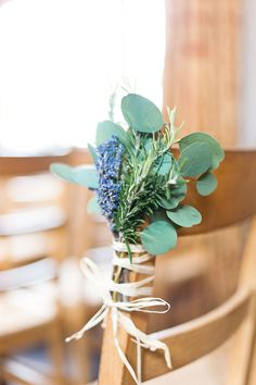 Eucalyptus and Lavender tied to the ceremony aisle chairs | African Theme Wedding | Rustic Barn Wedding | Image by Anushé Low | http://www.rockmywedding.co.uk/marisa-edward/