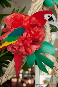 Tissue paper parrots a safari birthday party