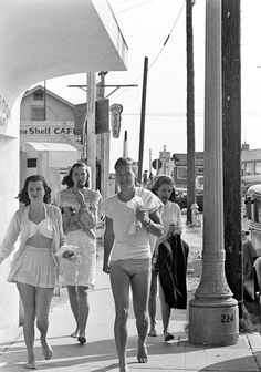 Beach town, 1940s found photo street bathing suits play suits fashion style