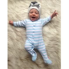 Some Baby's are born Entertainers. He is making us smile @itsjuliwilson #zutano #stripes #happy #baby