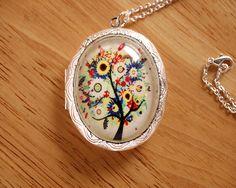 Perfume Locket Antique Inspired Resin Floral Tree Locket Pendant - you choose scent. $20.00, via Etsy.