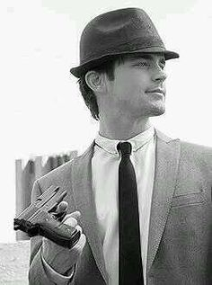 Matt Bomer as Neal Caffrey.  C'mon, Neal doesn't even like guns.