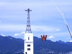 """Putting up the iconic """"W"""" onto Woodwards Places To Travel, Places To Visit, Vancouver Island, Old Pictures, British Columbia, Statue Of Liberty, Vintage Photos, The Past, Canada"""