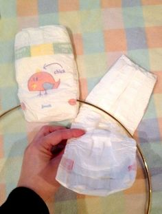 21 Adorable Baby Gifts That Will Make People Go Oooh and Ahhh is part of Diaper wreath - You might want to buy a box of diapers when you see what this woman did on her front door! This is the most adorable baby gift we've ever seen Diy Diapers, Baby Shower Diapers, Baby Boy Shower, Baby Shower Gifts, Baby Showers, Diaper Wreath Tutorial, Baby Hug, Baby Baby, Cute Baby Gifts