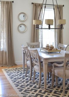 We love this neutral-colored chandelier that plays well against the natural linen fibers of the drapes.