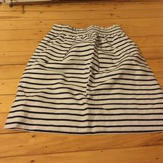 Jcrew stripped skirt Cinches at the waste and even has pockets! It says it is a 00 but I am usually a 2 so it can fit from 00-2 J. Crew Skirts Mini